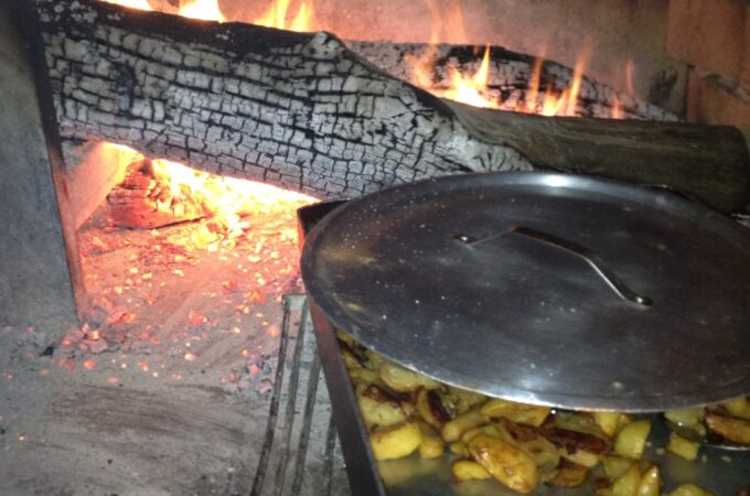 Potatoes cooking on wood-burning grill in Sacrofano