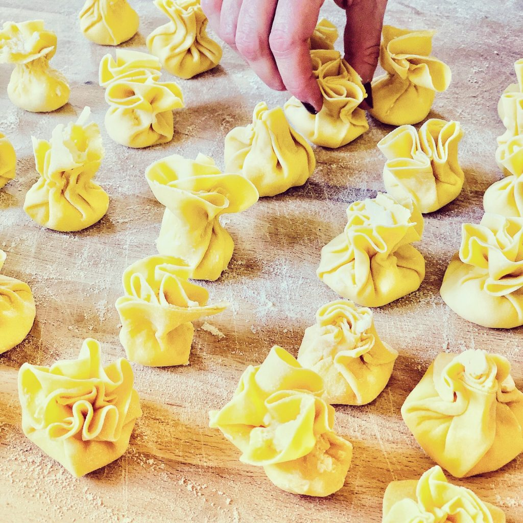 Ricotta and pear filled pasta sacks are fun and easy to make, plus they freeze well! Learn at our Online Cooking Classes!